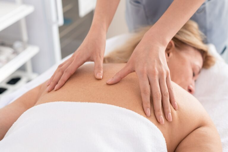 Giving relaxing back massage